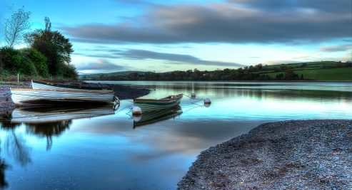 Three Boats, during blue hour, Macroom Lakes, Co. Cork. On this beautiful evening there was wind or water movement. I managed to capture this shot without having motion blur in the boats. This shot consists of 23 images
