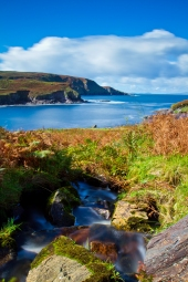 Taken on the hill above Cooncrome Harbour, with a small brook cascading its way down the the rocky shoreline, taken in the height of summer on a spectacular Irish day